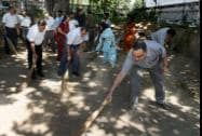 Air India emplyees sweep the ground as part of 'Swachh Bharat Abhiyan'