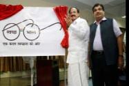 M Venkaiah Naidu & Nitin Gadkari releasing the logo of 'Swachchh Bharat Mission'