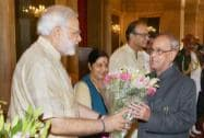 President Pranab Mukherjee recieves a bouquet of flowers from Prime Minister Narendra Modi,