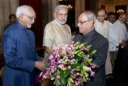 President Pranab Mukherjee recieves a bouquet of flowers from Vice President Mohammad Hamid Ansari