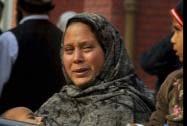 A Pakistani woman weeps as she waits at a hospital