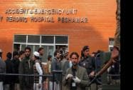 People gather at a hospital, where victims of a Taliban attack are being treated in Peshawar