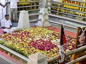 Tamil Nadu Chief Minister O Panneerselvam sitting in a meditation in front of late J Jayalalithaa's burial site at the Marina Beach