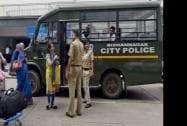 Passengers board the city police bus to reach the airport