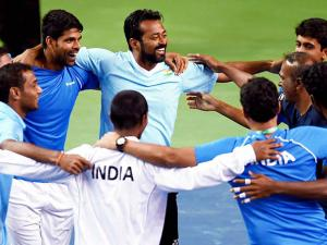 Indian team players celebrate after their victory over New Zealand in a Davis Cup