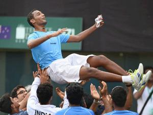 Indian tennis player Ramkumar Ramanathan being  lifted by his team mates after India wins