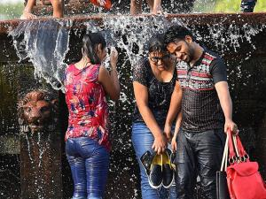 People enjoy at a water fountain at the India  as the mercury rises in New Delhi02