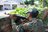 An army jawan takes position during an encounter with the militants who attacked a police station at Dinanagar