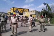 Punjab police personnel keep vigil during an encounter with armed militants near Dinanagar