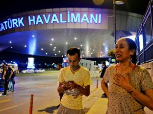 People gather on the entrance to Istanbul's Ataturk airport
