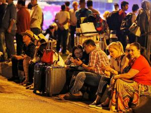 People gather outside Istanbul's Ataturk airport