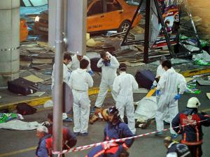 Turkish forensic police officers work at the scene of a blast outside Istanbul's Ataturk airport