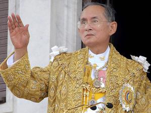 Thailand King Bhumibol Adulyadej acknowledges the crowd in Bangkok during the celebrations of the 60th anniversary