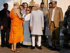 Vice President Hamid Ansari and his wife Salma Ansari during a visit to Buddhist Temple Wat Pho in _Bangkok