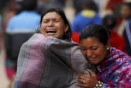 Family members break down during the cremation of an earthquake victim in Bhaktapur near Kathmandu