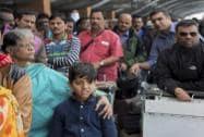 Indian nationals queue to go inside the Kathmandu international airport, in Kathmandu