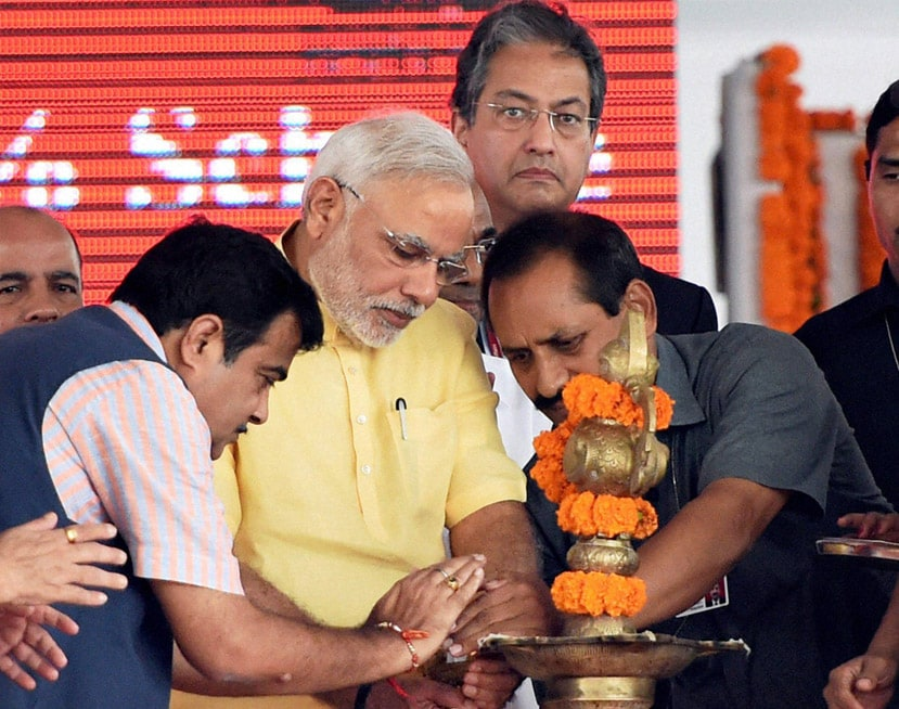 Prime Minister, Narendra Modi, foundation, stone, laying,  function, SEZ project, Jawaharlal Nehru Port Trust (JNPT)  Nitin Gadkari, Minister of Road Transport and Highways, lighting, lamp