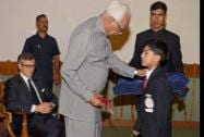 Jammu and Kashmir Governor NN Vohra presenting the Sportsperson for the year 2014 award to Zakariya Yaseen Bhat as Chief Minister Omar Abdullah