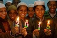 Children hold candles welcoming the new year 2015