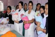 Nurses hold babies born in New Year at a government hospital
