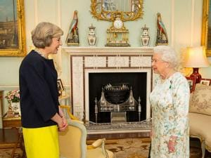 Queen Elizabeth II speaks with Theresa May at the start of an audience in Buckingham Palace