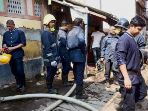 Fire personnel carry out rescue and relief works after flooring of a public toilet collapsed at Indira Nagar