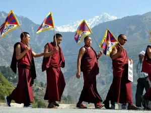 Tibetan monks take out a rally on the occasion of the 57th Tibetan National Uprising Day in Dharamsala