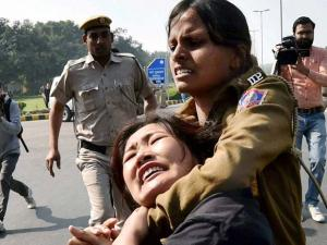 A Tibetan exile student being detained by police at a protest outside the_Chinese Embassy in New Delhi on Thursday against the Chinese rule in Tibet