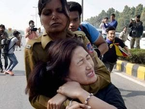 A Tibetan exile student being detained by police at a protest outside the Chinese Embassy in New Delhi on Thursday against the Chinese rule in Tibet
