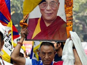 Tibetans take part in a protest on the 57th Tibetan Uprising day at Jantar Mantar in New Delhi