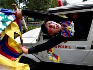 A Tibetan Youth Congress activist being detained by police at a protest outside the Chinese Embassy