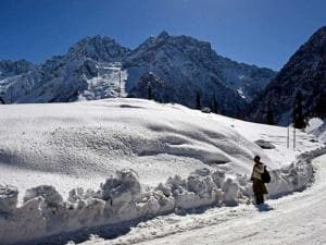 A man looks on at Thajiwas Glacier at snow covered Sonamarg