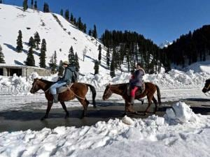 Tourists  enjoying horse ride at snow coverd Sonamarg