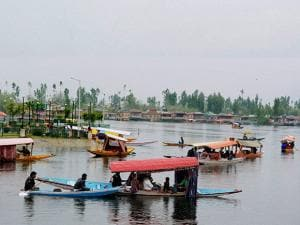 Tourists ride Shikaras as they enjoy the cool weather at Dal Lake in Srinagar (2)