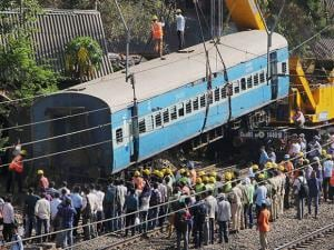 Restoration work in progress after an empty coach derailed off a slow track between Lower Parel and Elphinstone railway station, in Mumbai