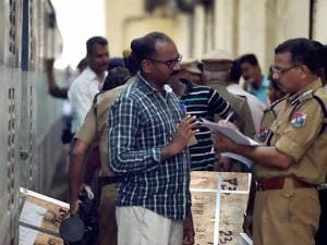 Police recovering one of the four boxes at Egmore Railway Station in Madras