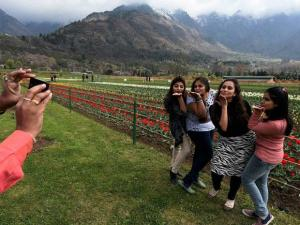 Female tourists enjoying_at Asia's largest Tulip garden that was thrown open on the foothills of Zabarwan range in Srinagar