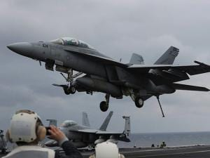 A U.S. Navy's FA-18 Super Hornet fighter approaches the deck of the Nimitz-class aircraft carrier USS Carl Vinson