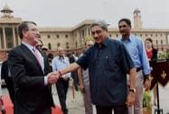 Defence Minister Manohar Parrikar shakes hands with US Secretary of Defence Ashton Carter