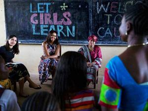 Actress Freida Pinto with the US First Lady Michelle Obama in Monrovia as part of a visit to meet young girls