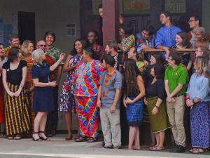U.S. first lady Michelle Obama laughs with Peace Corps members at a project