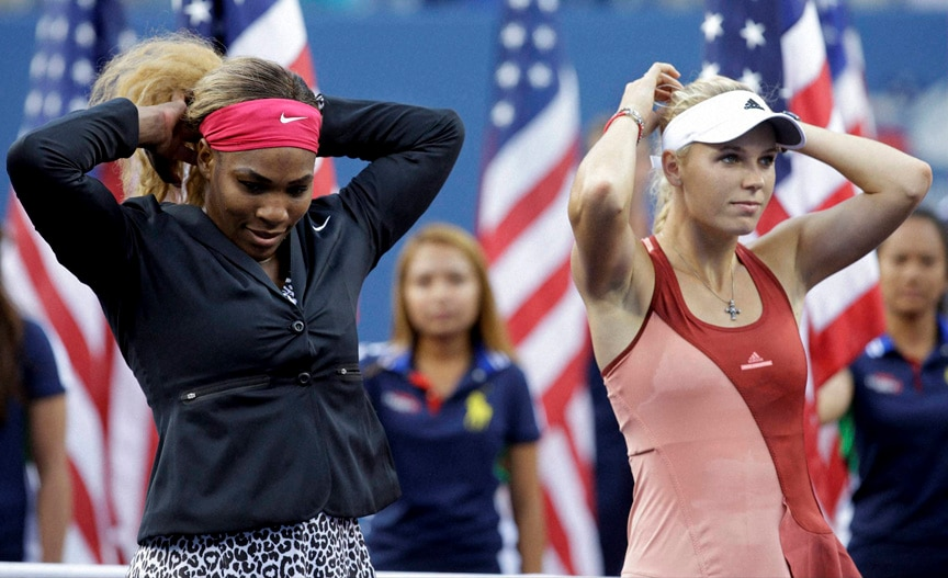 Serena Williams, Caroline Wozniacki, Denmark  wait for the start of the trophy ceremony after Williams defeated Wozniacki in the championship match of the 2014 U.S. Open tennis tournament