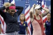 Serena Williams and Caroline Wozniacki of Denmark  wait for the start of the trophy ceremony