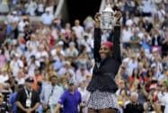 Serena Williams of the United States holds up the championship trophy