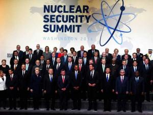 Prime Minister Narendra Modi (2nd row L), US President Barack Obama (R) during the family photo of world leaders attending the Nuclear Security Summit in Washington