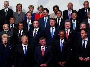 Prime Minister Narendra Modi (2nd row left), US President Barack Obama (front row 3rd right) and Chinese President Xi Jinping (front row right) during the family photo of world leaders atten