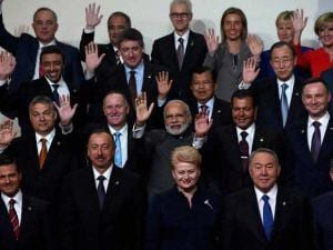 Prime Minister Narendra Modi (C) waves  during the family photo with world leaders attending the Nuclear Security Summit in Washington