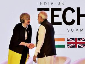 Narendra Modi shakes hands with UK counterpart Theresa May