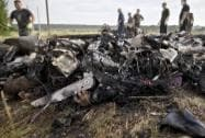 Human remains are seen amongst aircraft parts as emergency workers look for bodies at the crash site