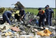 Ukrainian emergency workers dismantle the wreckage at the crash site
